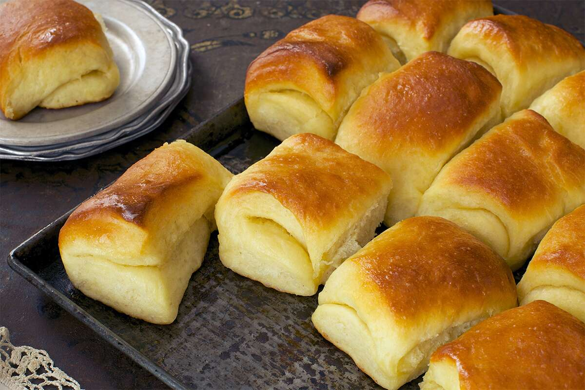 A tray of buttery, freshly baked Parker House Rolls