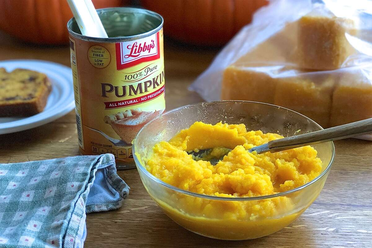 Opened can of pumpkin, bowl of homemade pumpkin purée