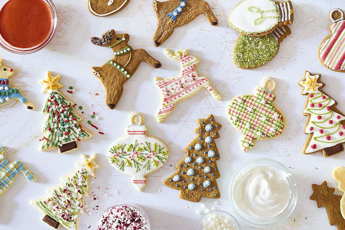 Christmas-themed cookies decorated with naturally colored icing