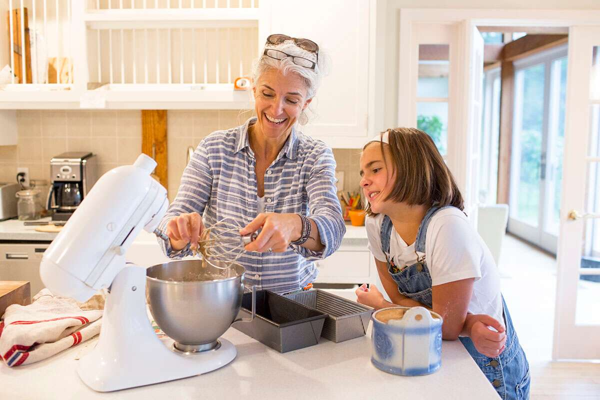 Woman and young girl baking together
