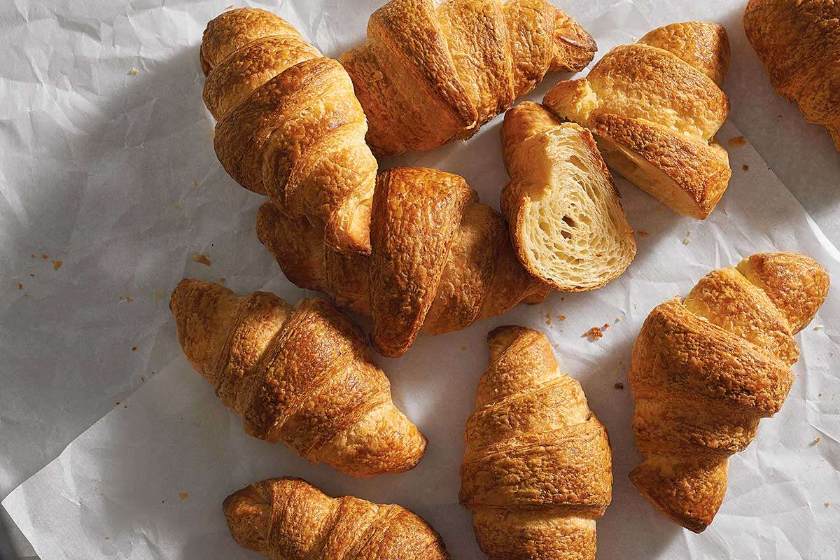 Multiple freshly baked croissants