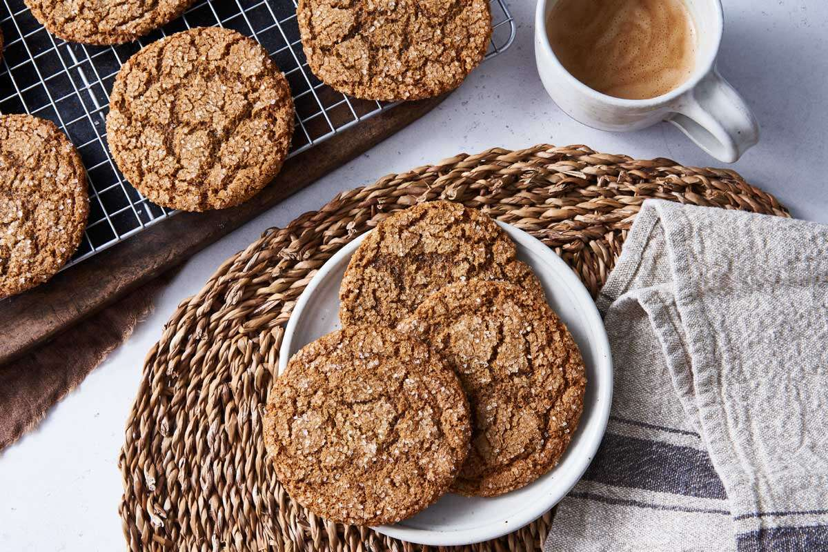 Spiced rye ginger cookies on plate and cooling rack