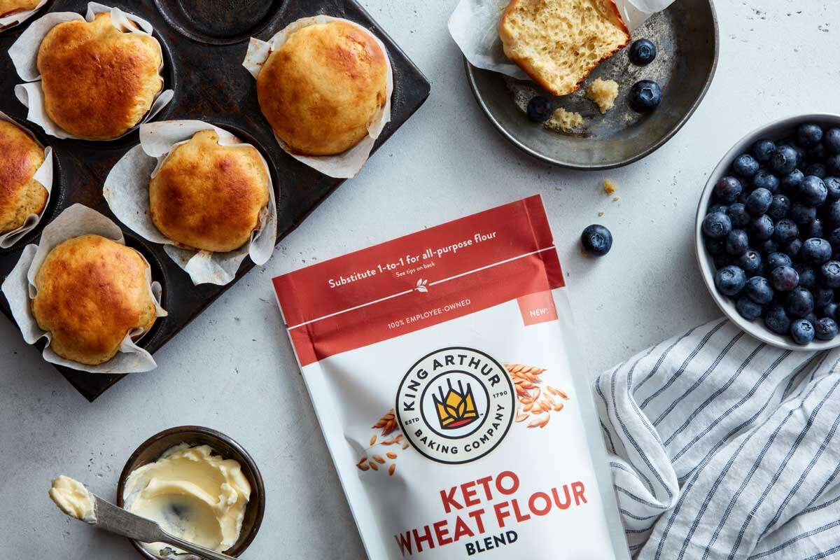 Bag of keto wheat flour next to muffins