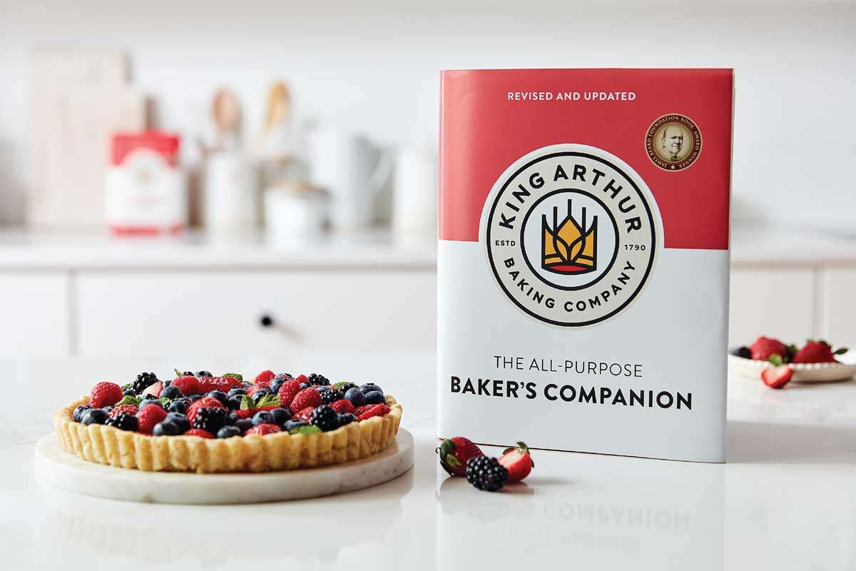 New Baker's Companion cookbook next to tart