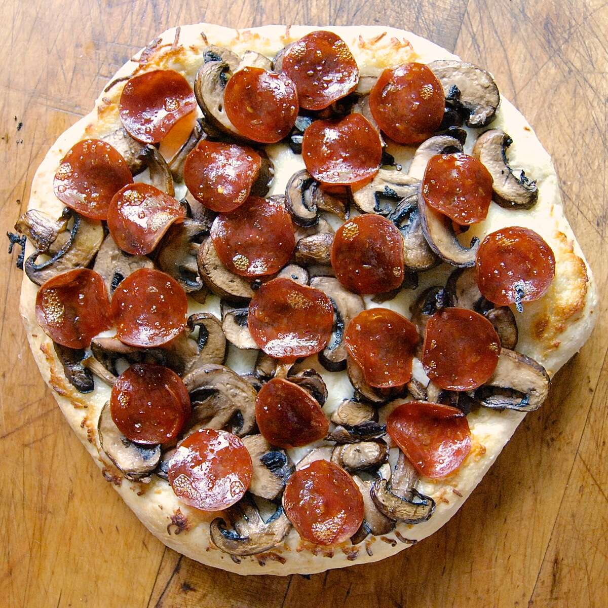Turn no-knead bread dough into pizza crust via @kingarthurflour