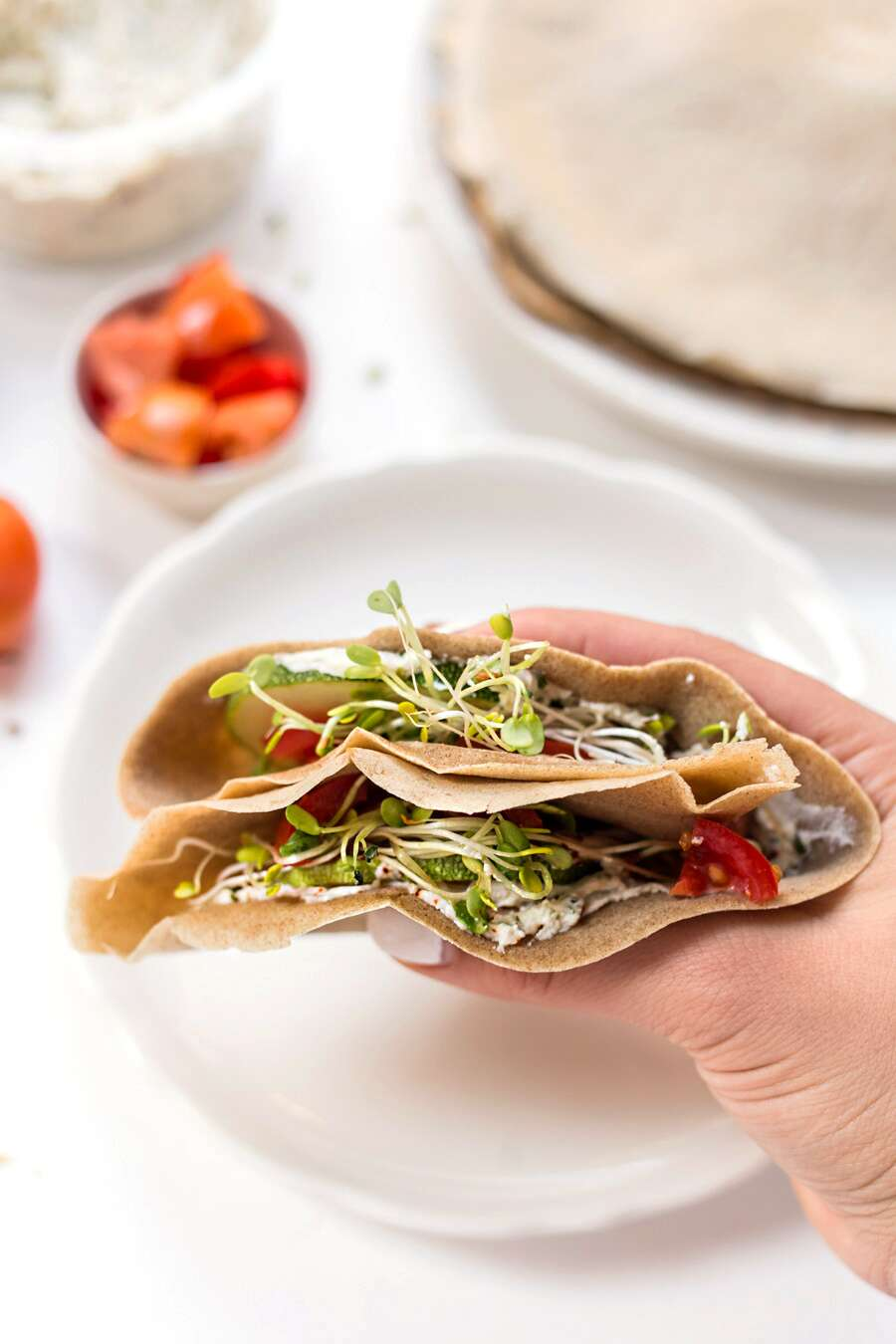Teff Crepes filled with cream cheese, tomatoes & sprouts -- via @kingarthurflour