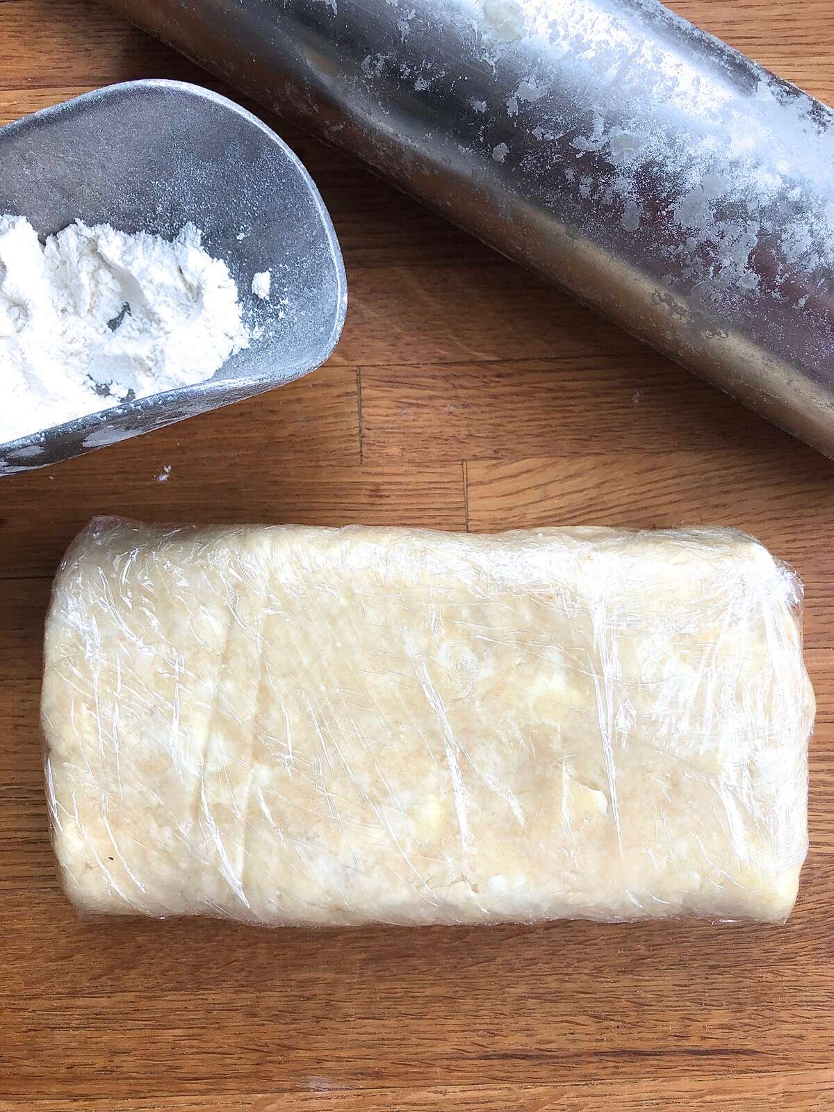 Super-flaky pie crust dough wrapped in plastic for the refrigerator