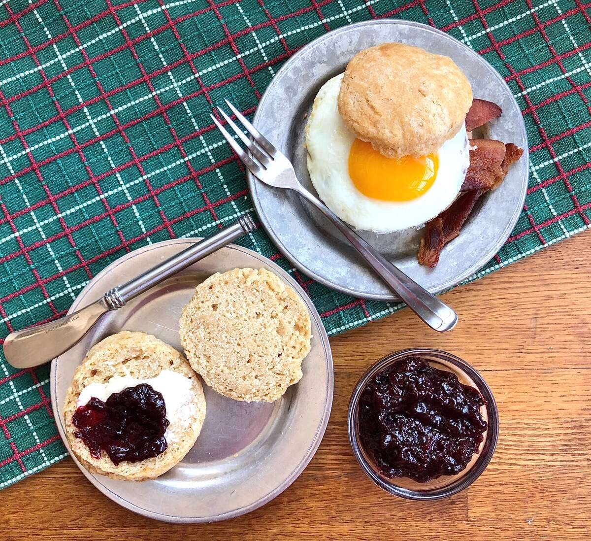 Whole wheat sourdough biscuits made into a breakfast sandwich, and simply spread with butter and jam.