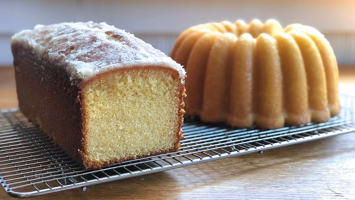 "Orange pound cakes, one baked in a 9"" x 4"" loaf pan, one in a bundt pan"