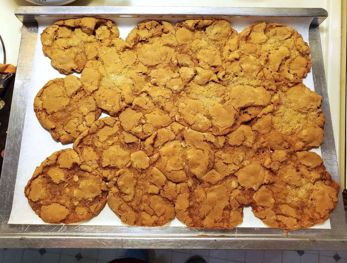 Oatmeal cookies baked into a giant puddle on a baking sheet.