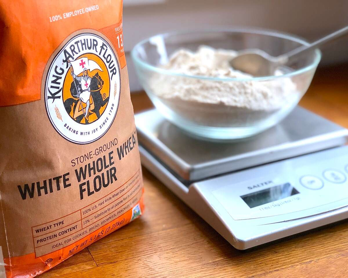 Bag of King Arthur White Whole Wheat Flour, bowl of flour on scale