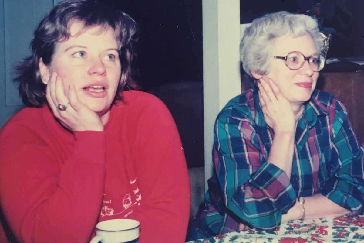 Two women sitting side by side, mother and daughter