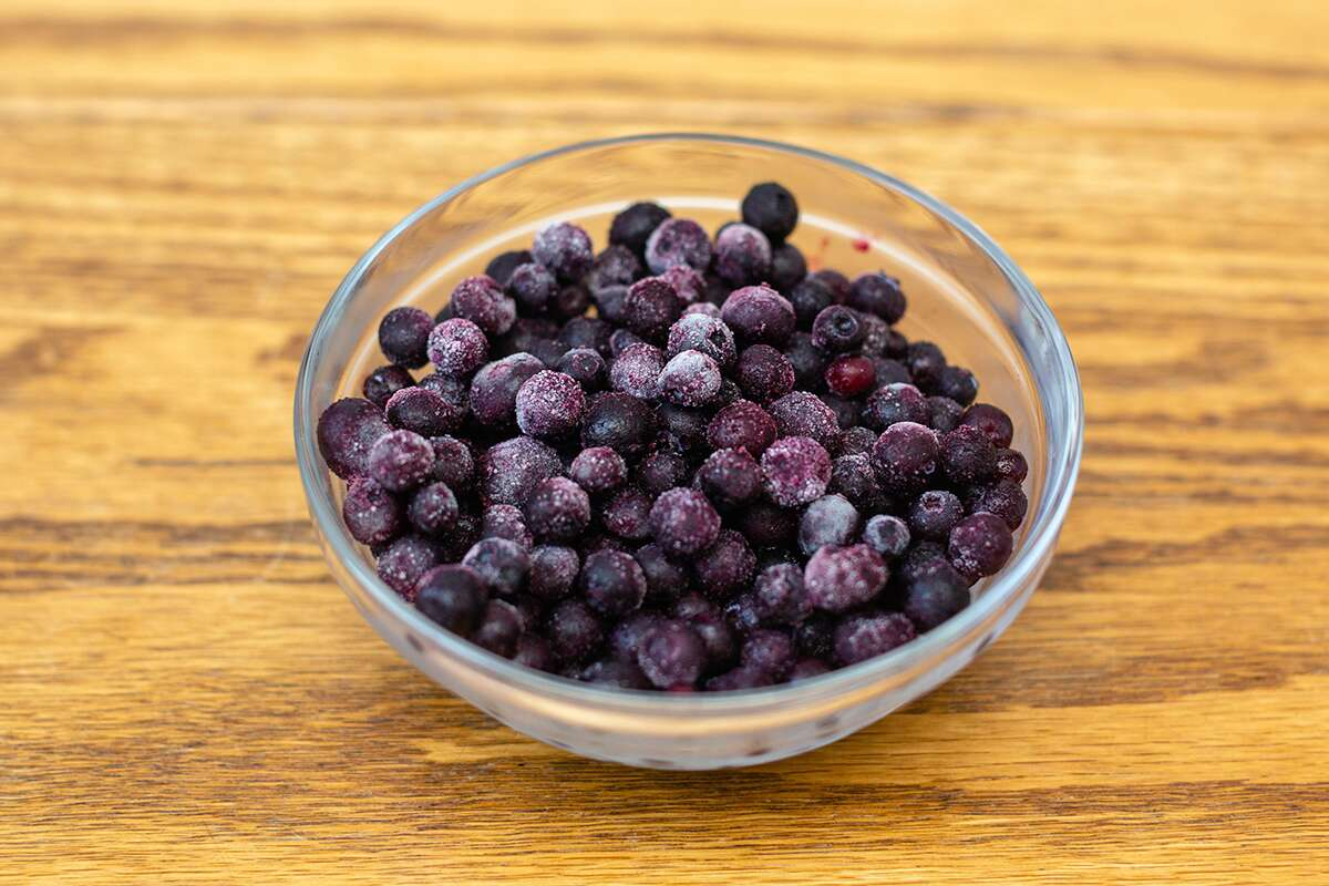 A bowl of frozen blueberries, ready for baking