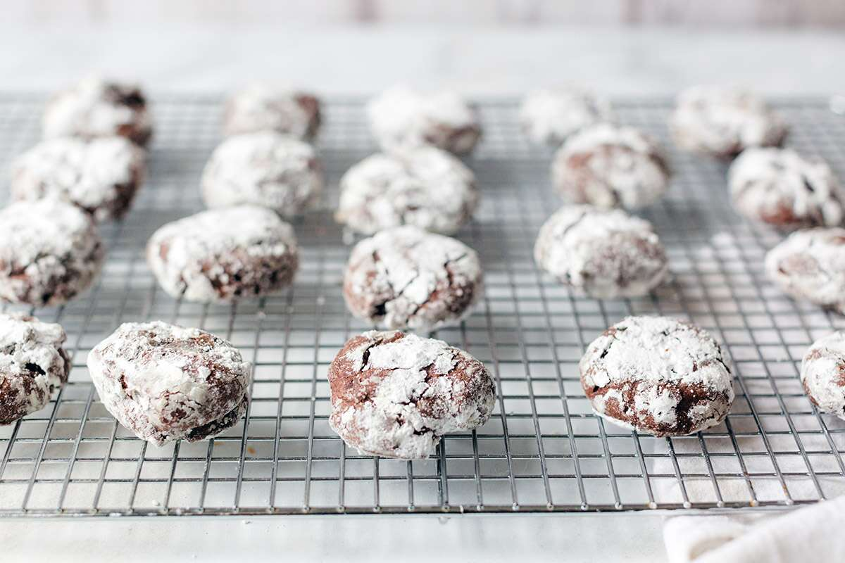 A batch of Chocolate Crinkles on a cooling rack