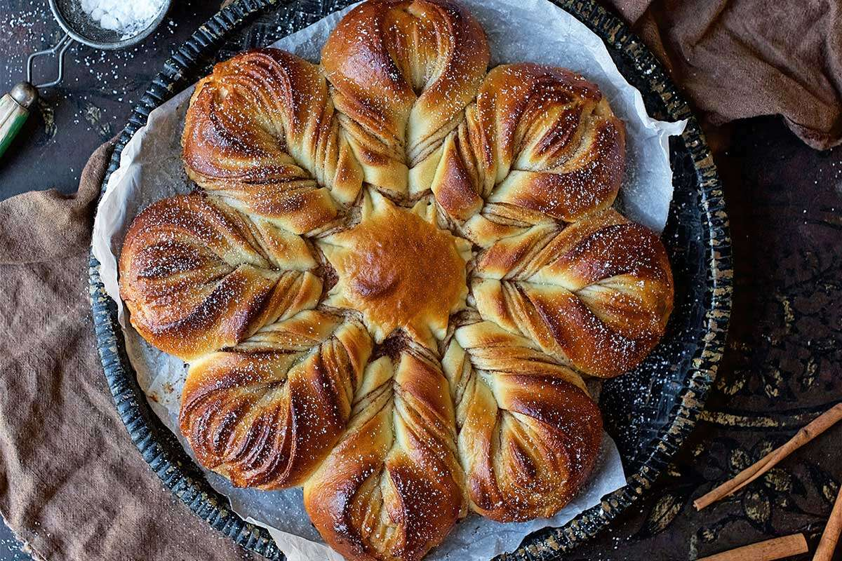 A baked cinnamon star bread filled with cinnamon-sugar