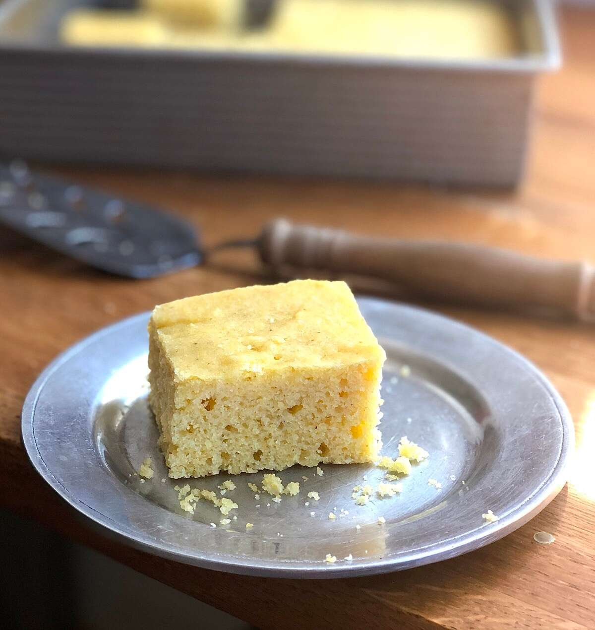 Square of cornbread on a plate ready to be served