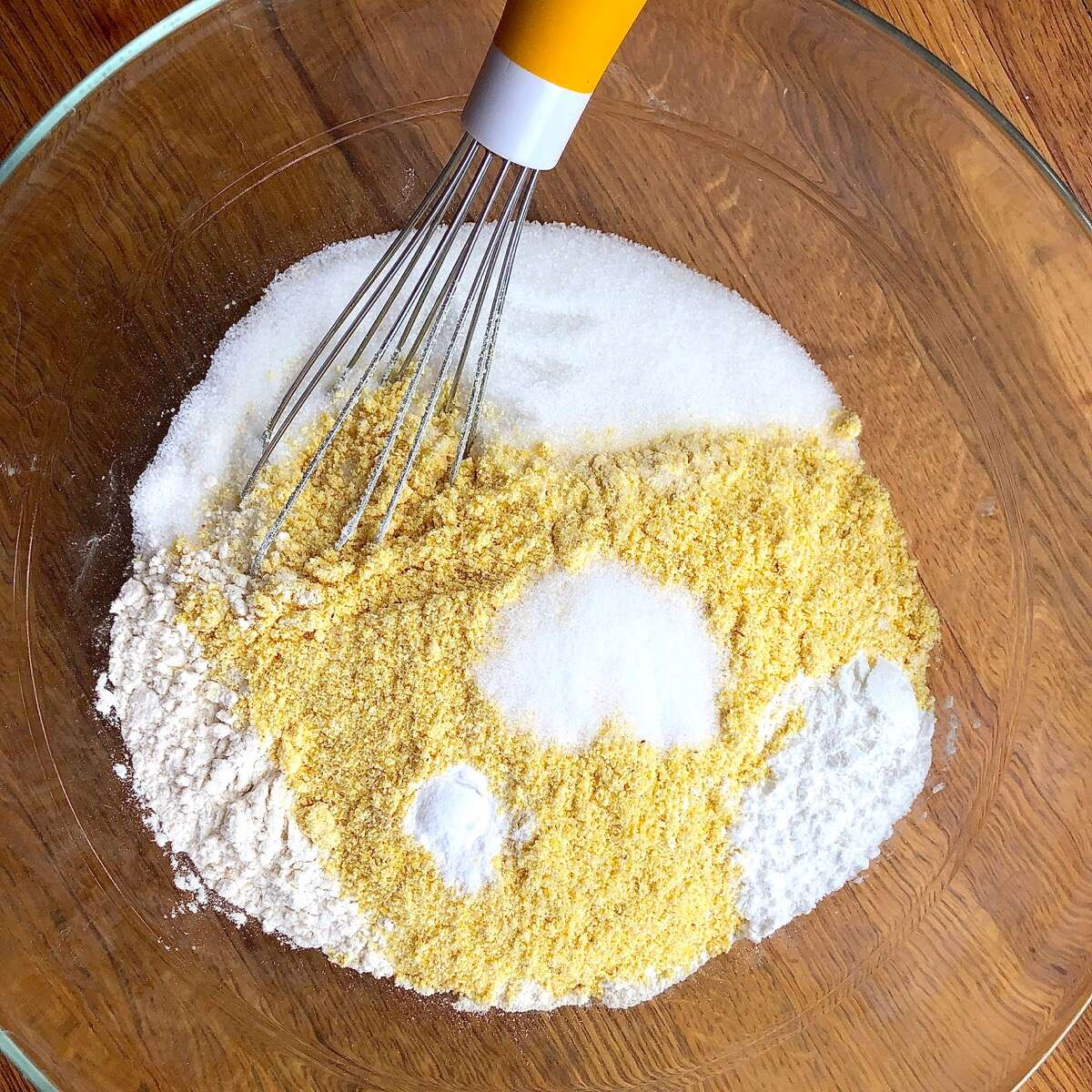 Dry ingredients for cornbread in a bowl ready to be whisked