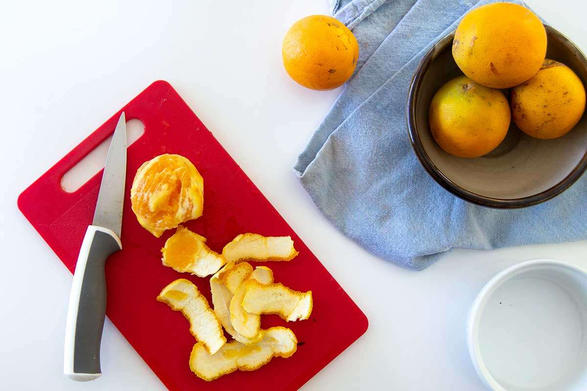 Slices of orange peels on a cutting board