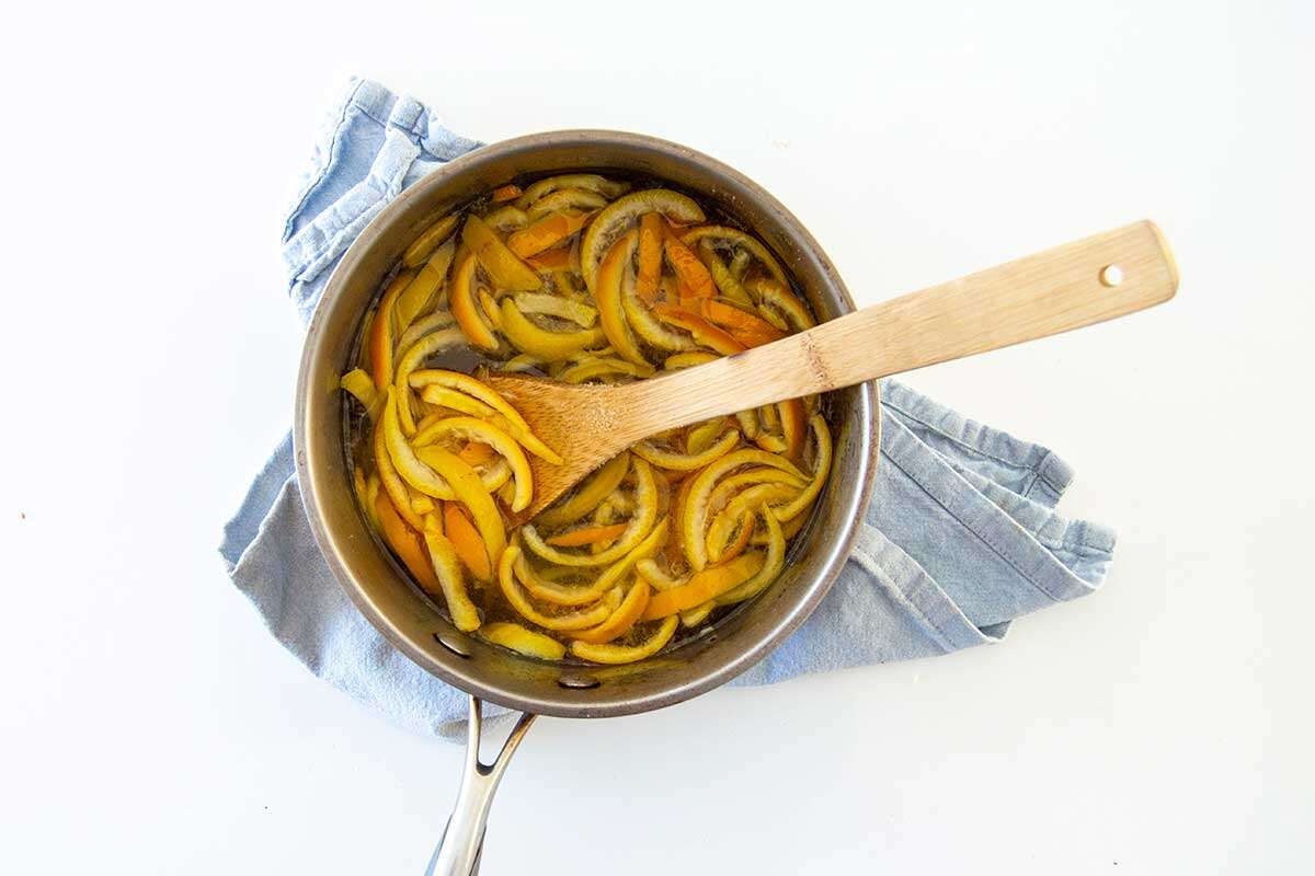 Saucepan with blanched orange peels