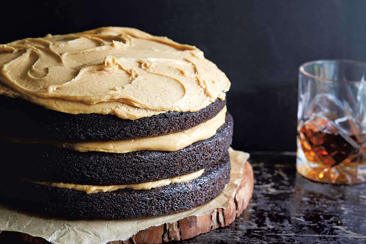 A three layer chocolate cake topped and filled with peanut butter frosting