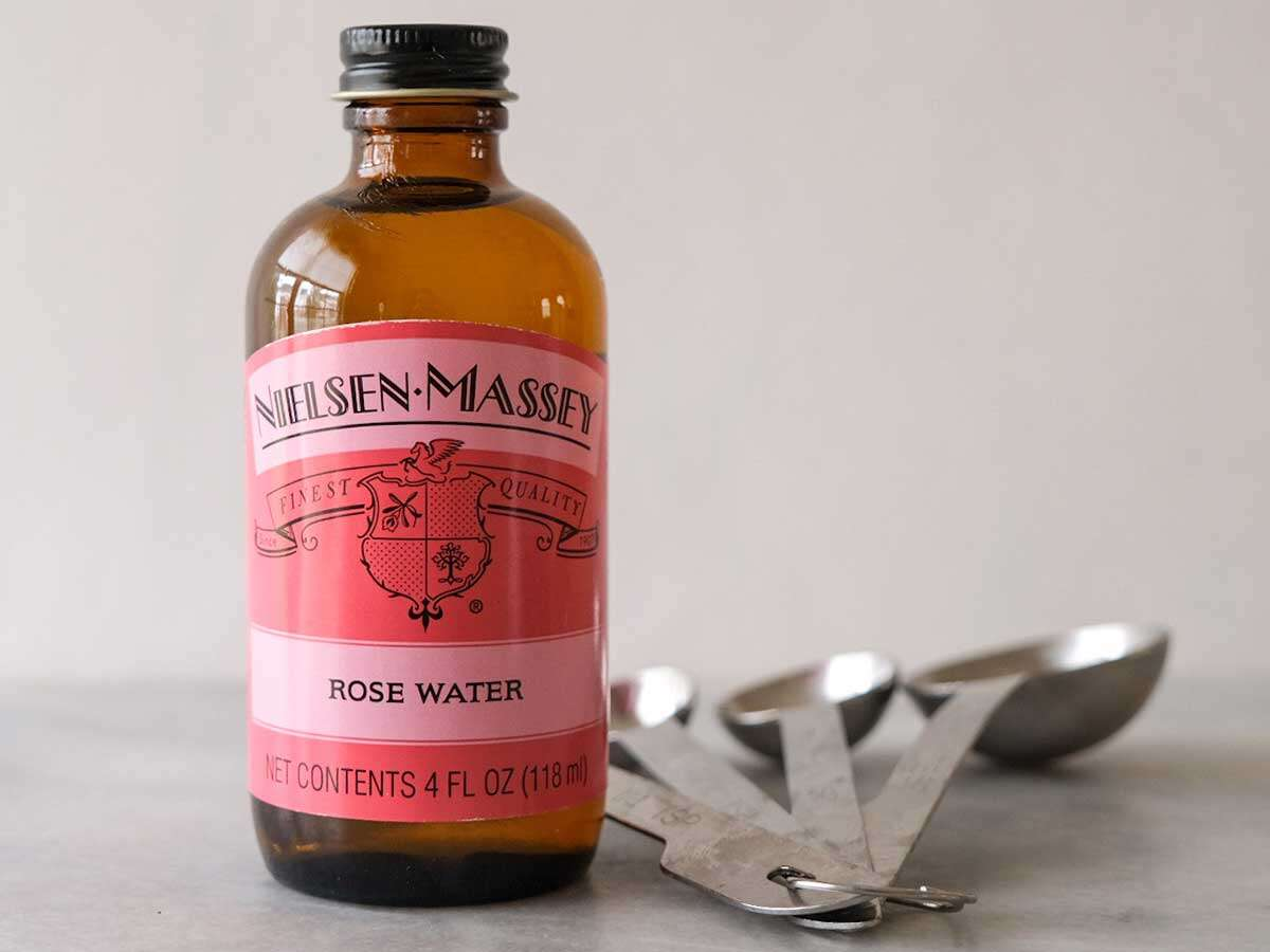 Bottle of rose water on counter