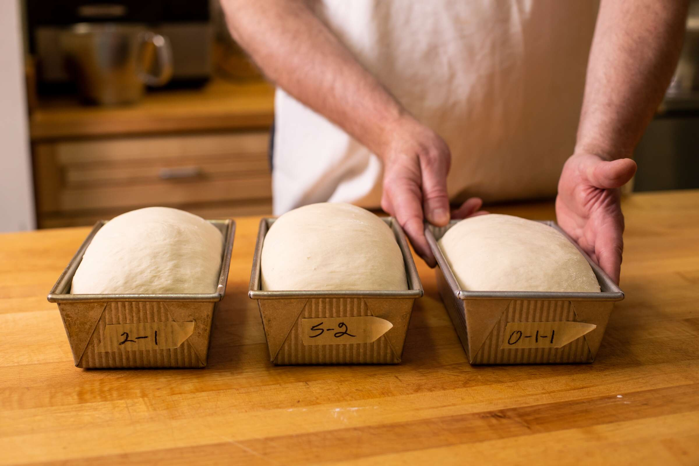 Dough sits in baking pans, ready for the oven