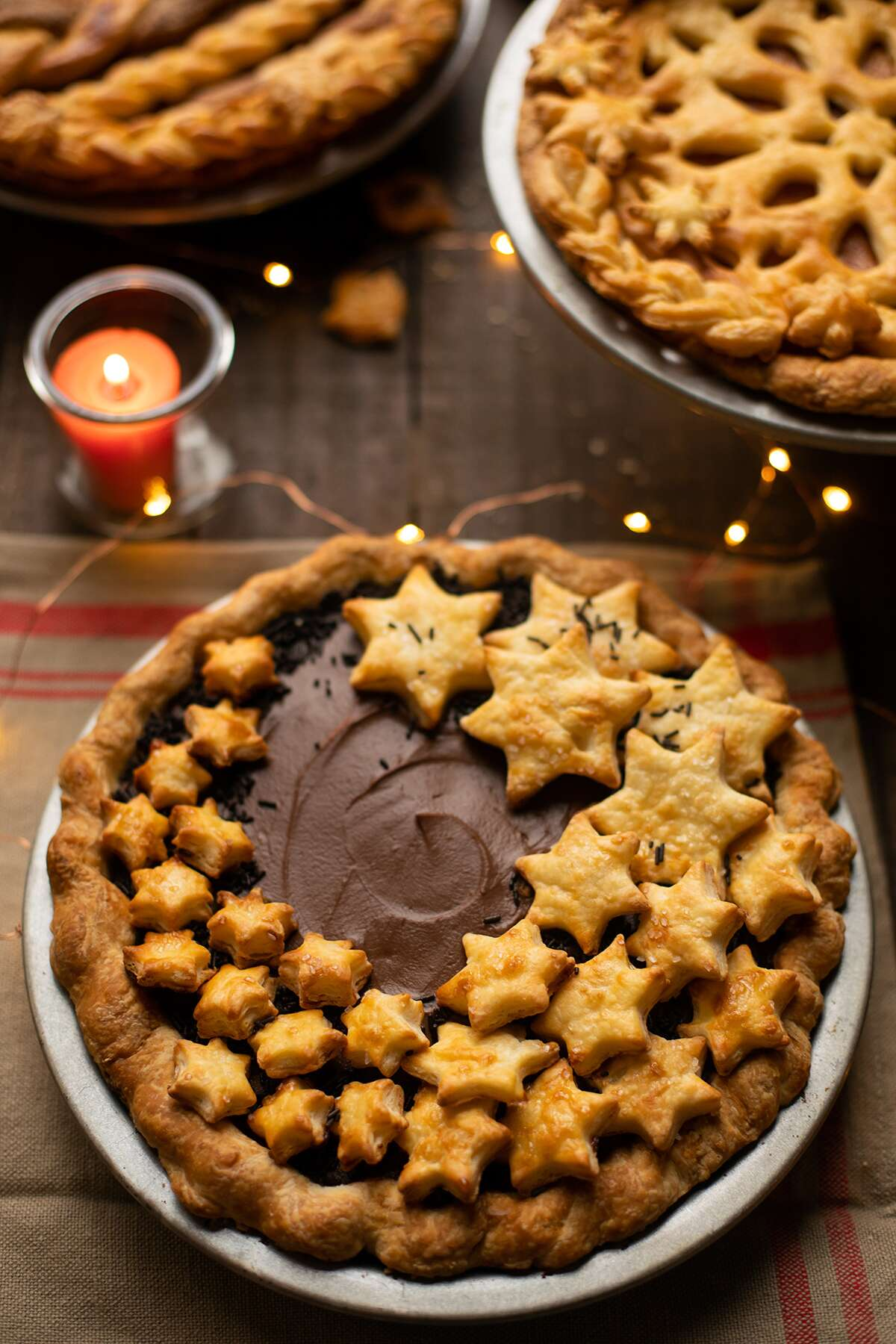 Chocolate cream pie with star-shaped pie crust cutouts on top
