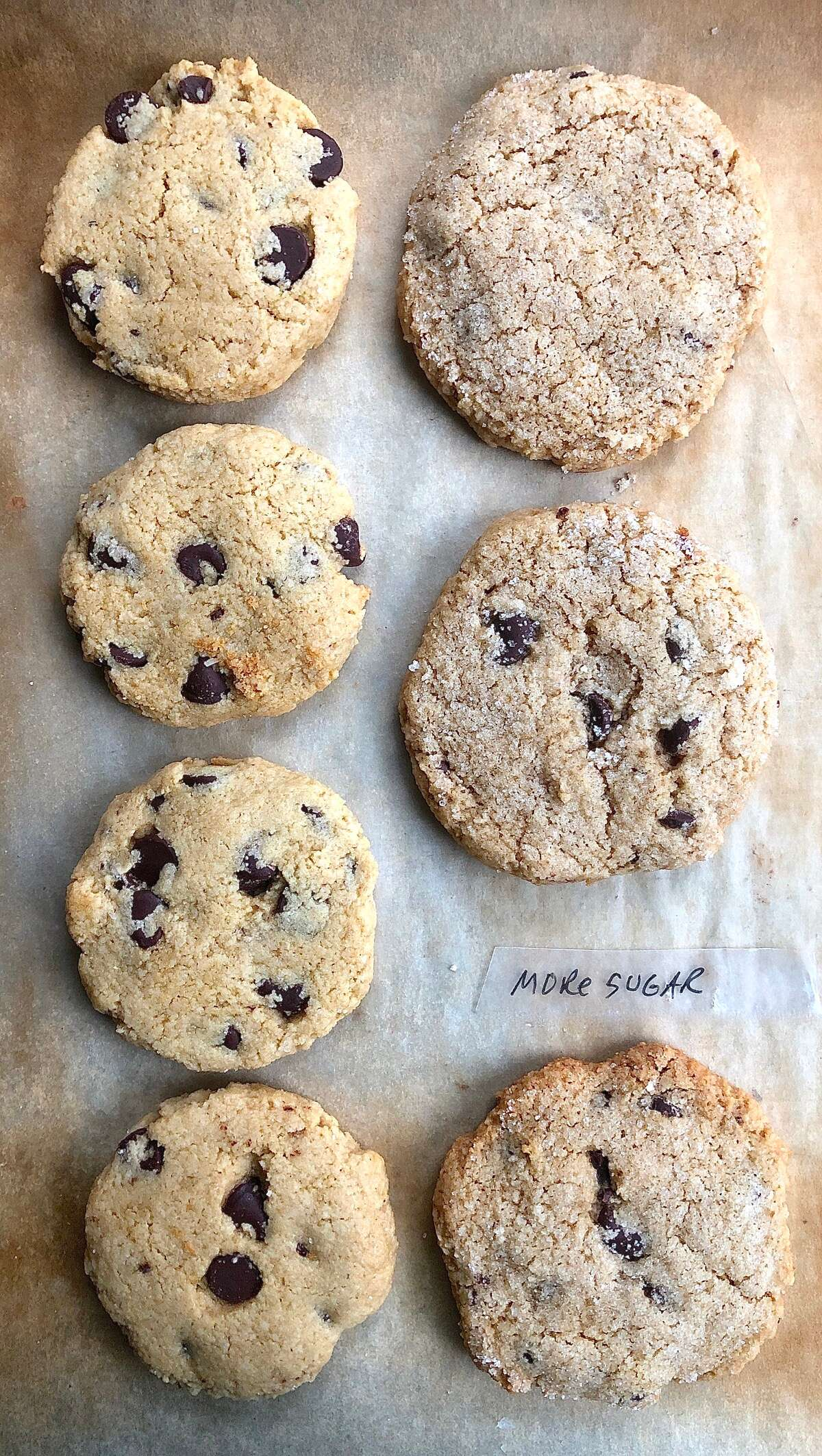 Gluten-Free Almond Flour Chocolate Chip Cookies,  less sweet and sweeter versions, on a baking sheet.