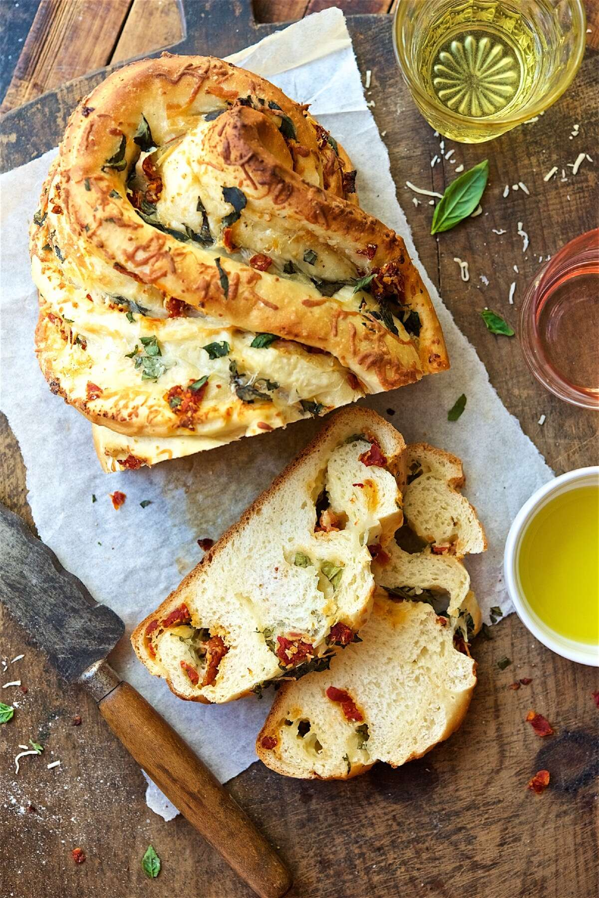 Pane Bianco, a filled. twisted bread stuffed with roasted tomatoes, cheese, garlic, and basil.