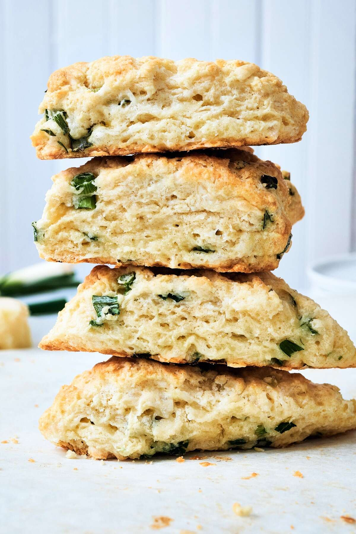 Stack of four Cheddar and Scallion Scones.