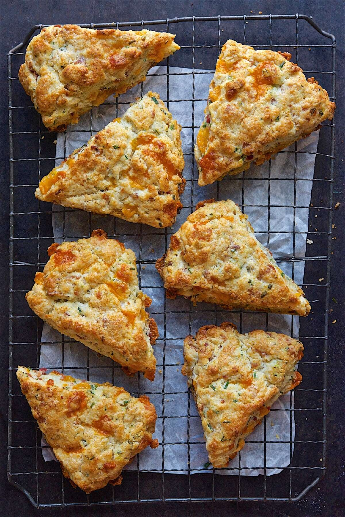 Bacon-cheddar-chive scones on a cooling rack.