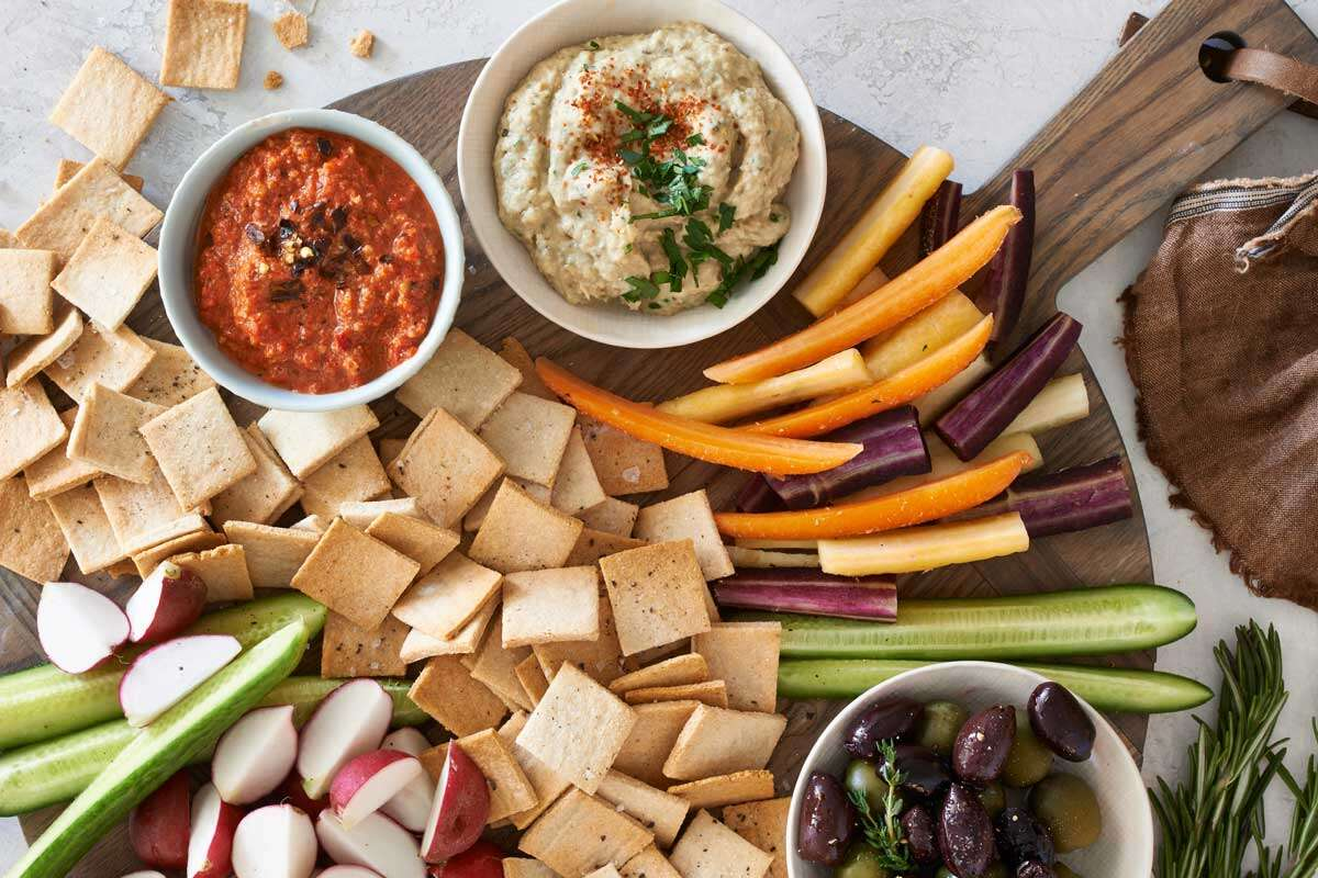 Paleo crackers and vegetables spread