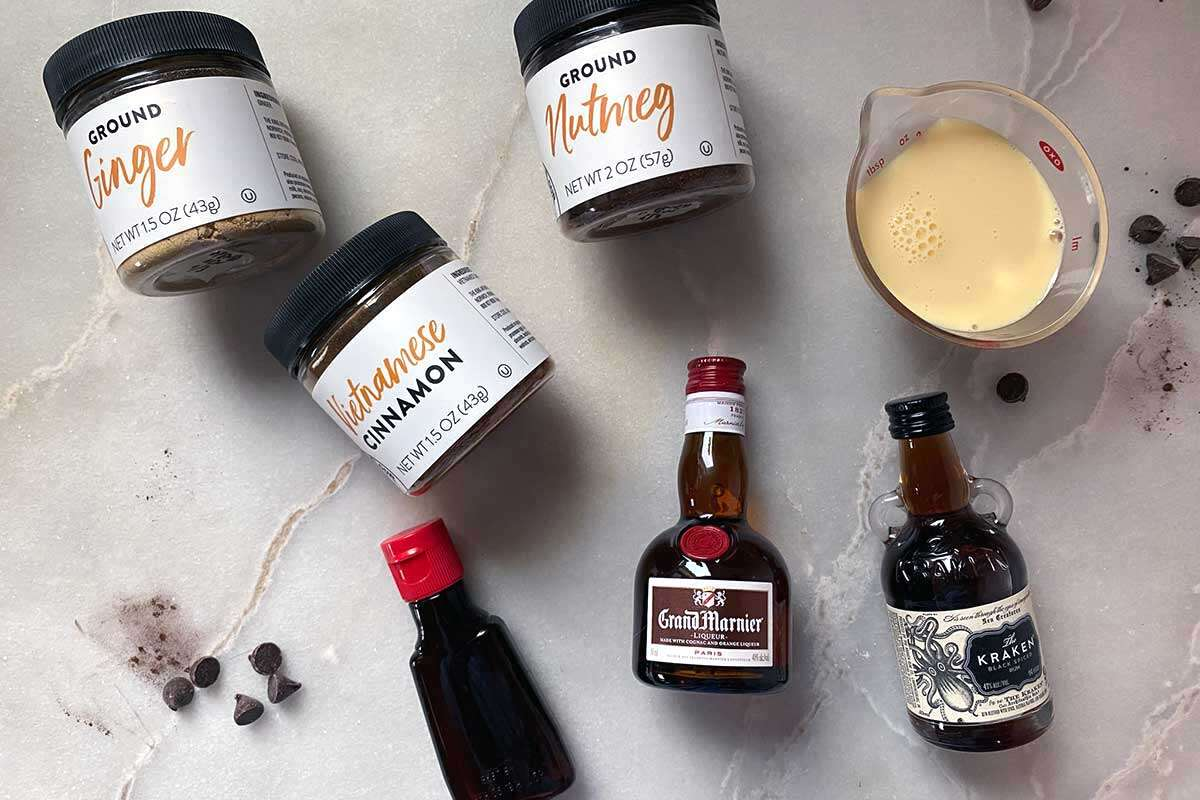 Small bottles of liquor as well as spices to flavor a flourless chocolate cake