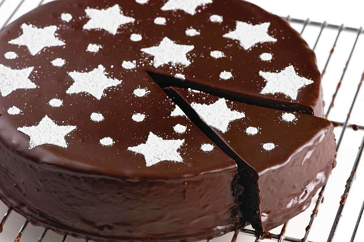 A flourless chocolate cake stenciled with stars on top
