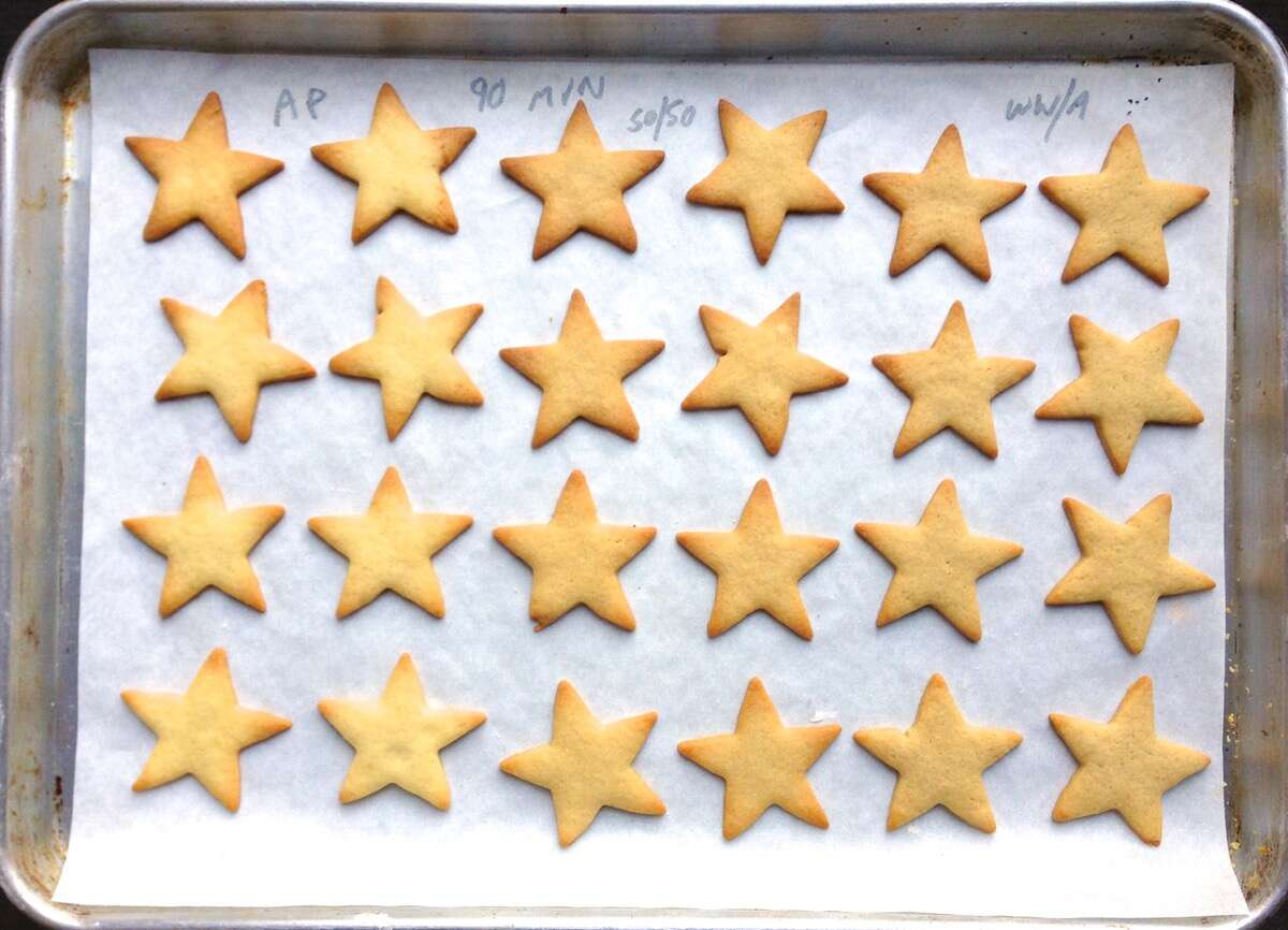 Cutout star cookies showing color differences between 100% white flour and 100% whole wheat flour.