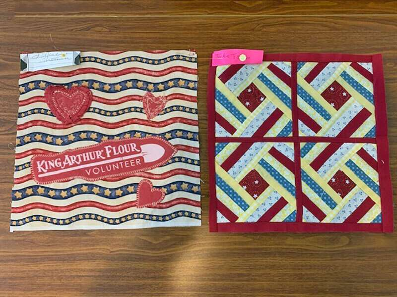 Two quilt squares, including Jackie Sherwin's inspired by volunteering