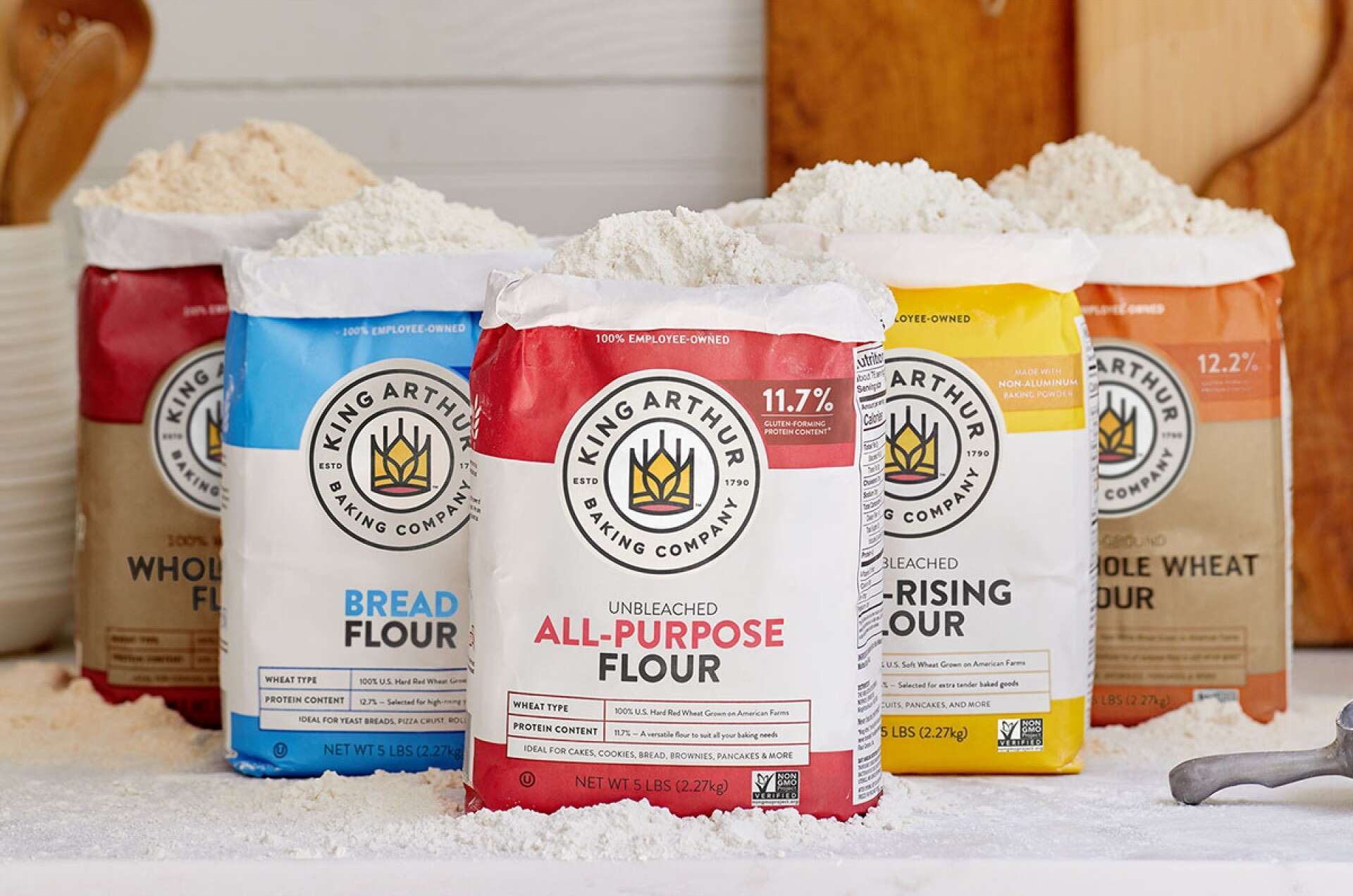 Bags of King Arthur flour featuring the new King Arthur Baking Company logo