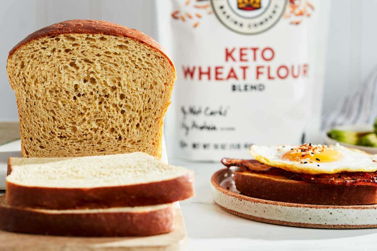 Sliced keto bread with flour in the background