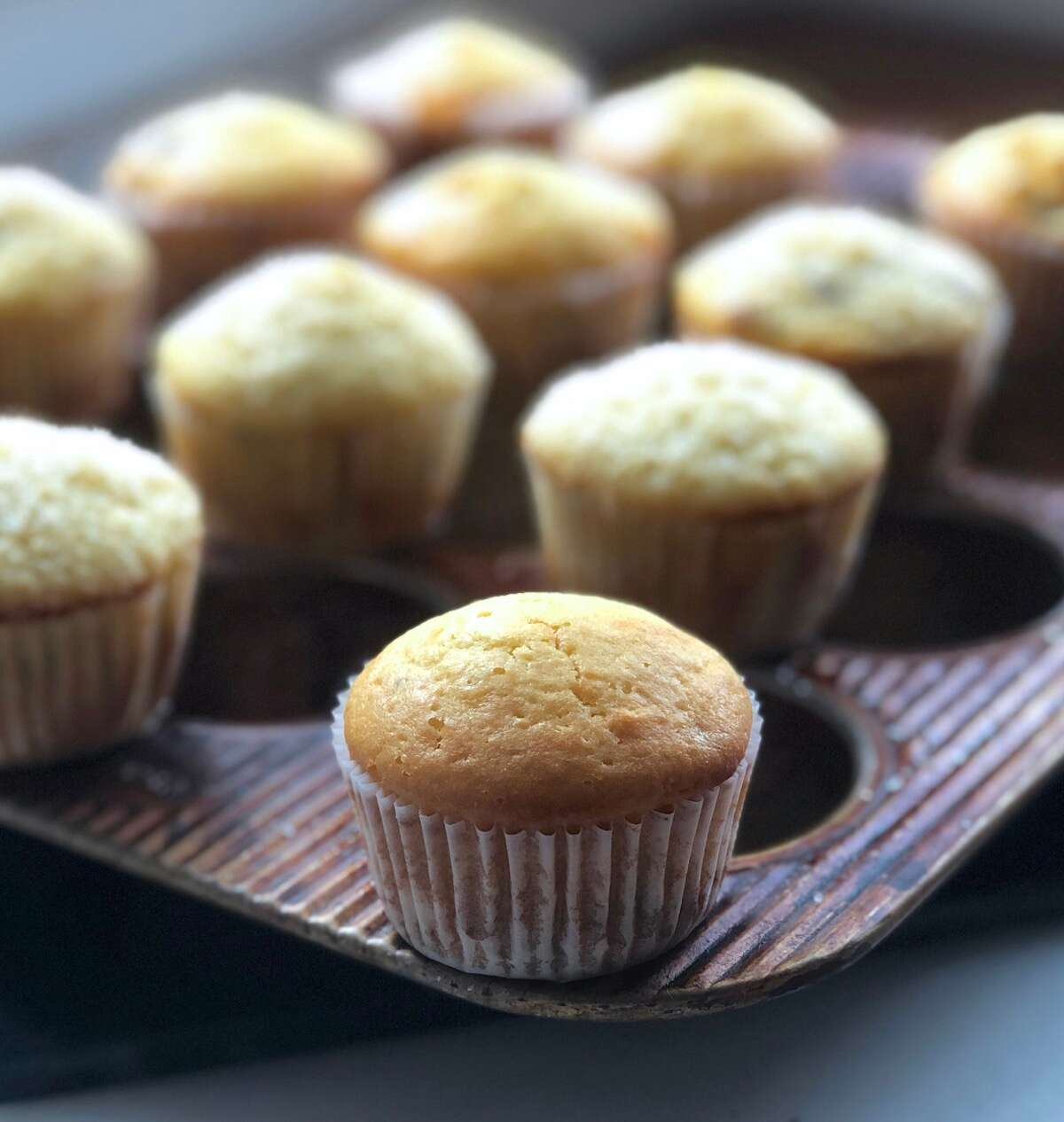 Muffins made with Baking Sugar Alternative cooling atop a muffin pan.