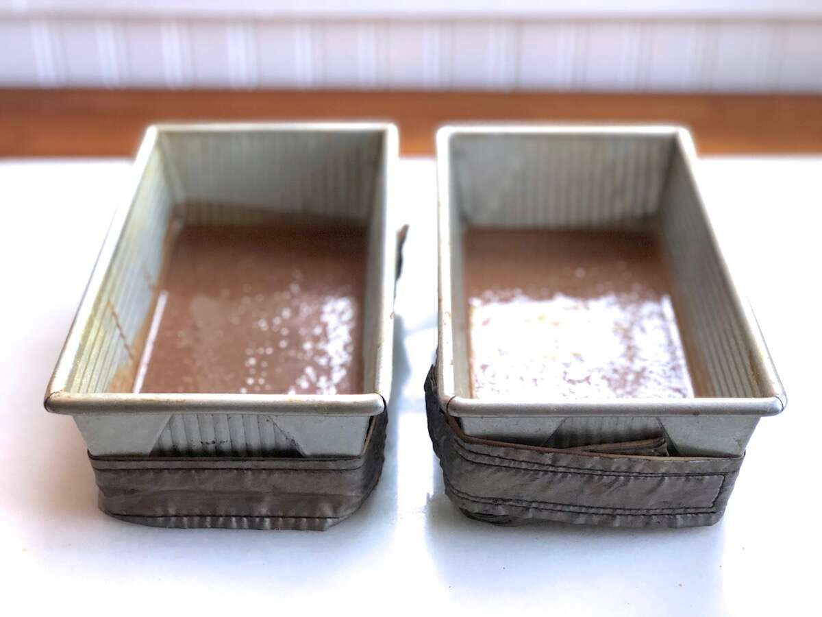 Chocolate Cake Pan Cake batter in two loaf pans, one batter made with Baking Sugar Alternative, one with regular granulated sugar.