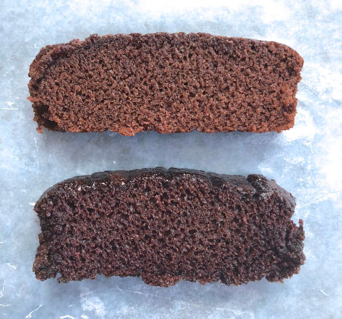 Two slices of chocolate cake, one made with Baking Sugar Alternative, one with regular cane sugar, showing their relative rise.