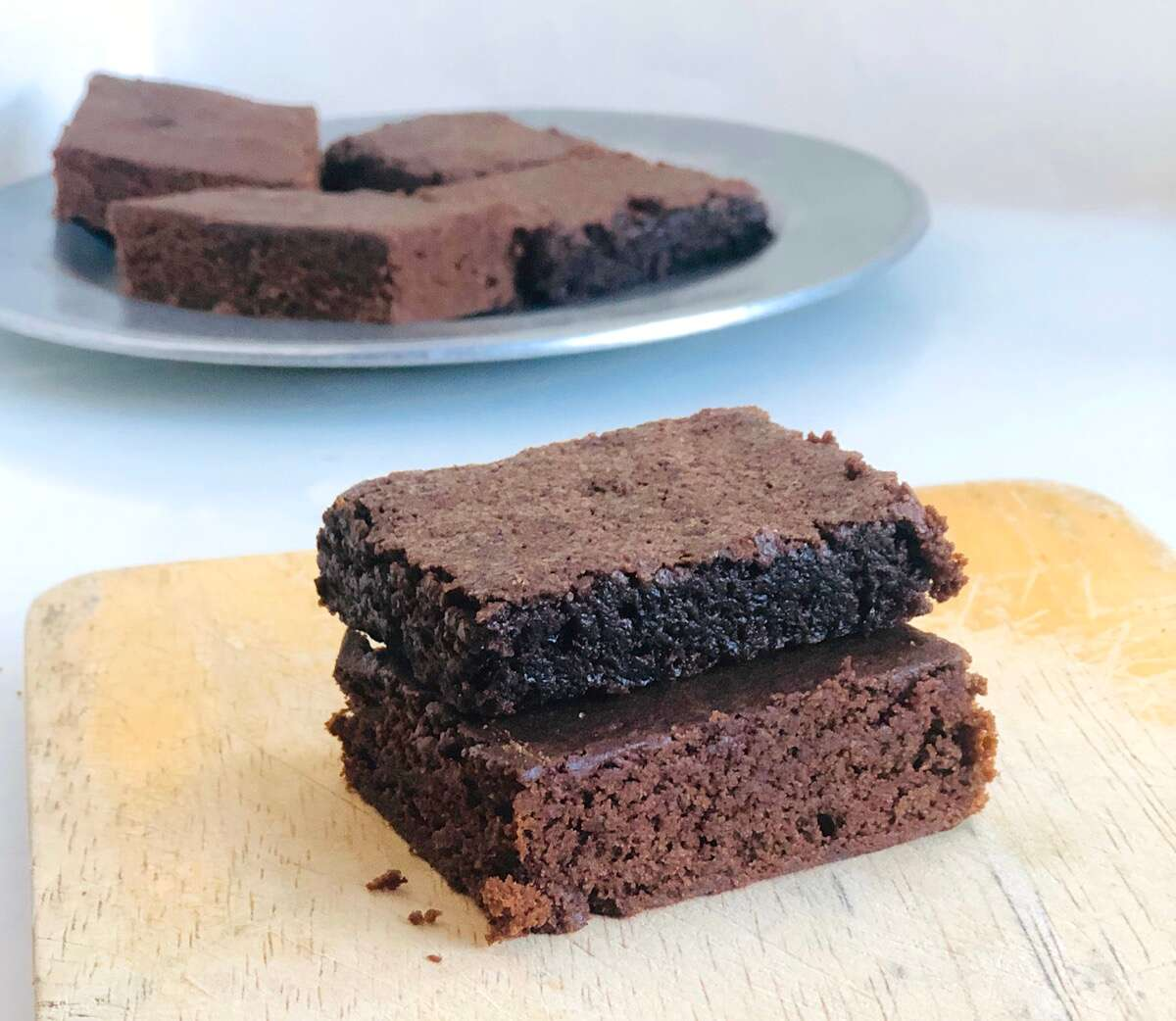 Two brownies, one made with Baking Sugar Alternative, one with regular cane sugar.