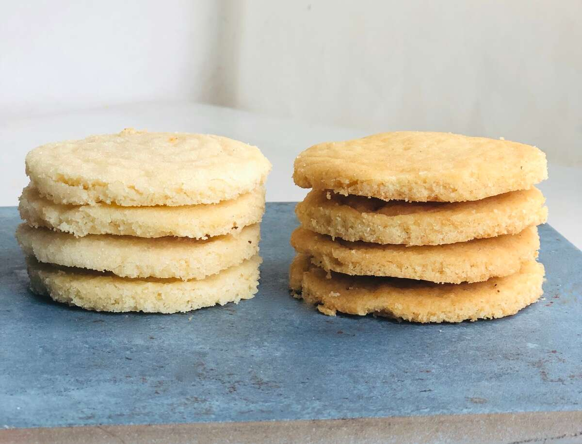 Two stacks of Vanilla Sugar Cookies, one made with Baking Sugar Alternative, one with regular cane sugar.