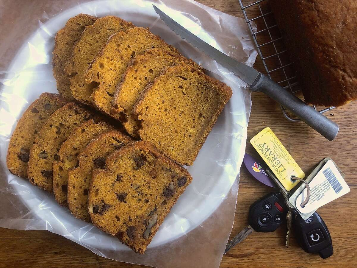 Slices of pumpkin bread on a paper plate, ready to give away