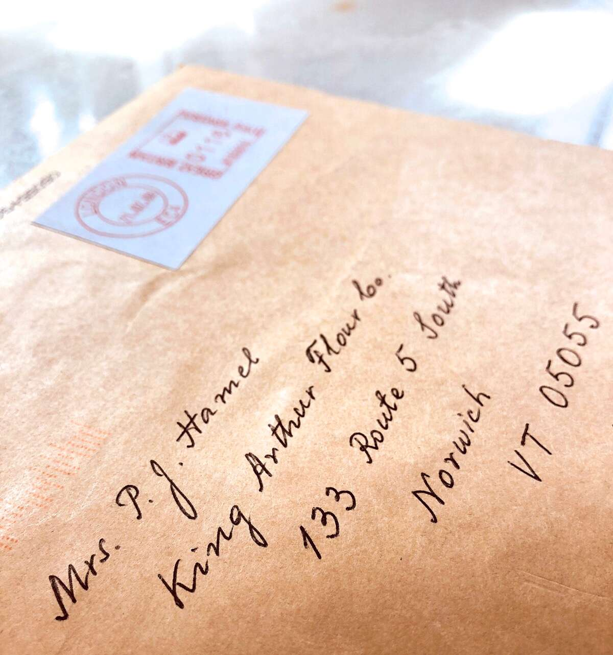 An envelope hand-addressed to King Arthur Flour.