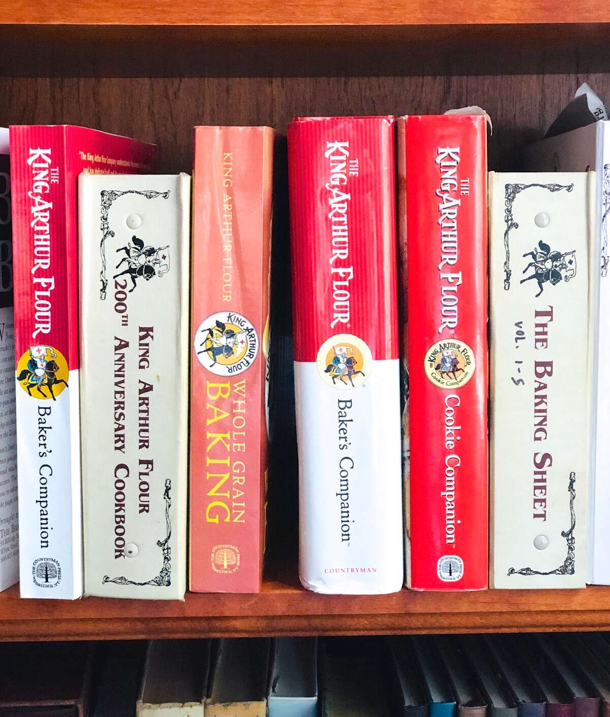 King Arthur cookbooks on a shelf.