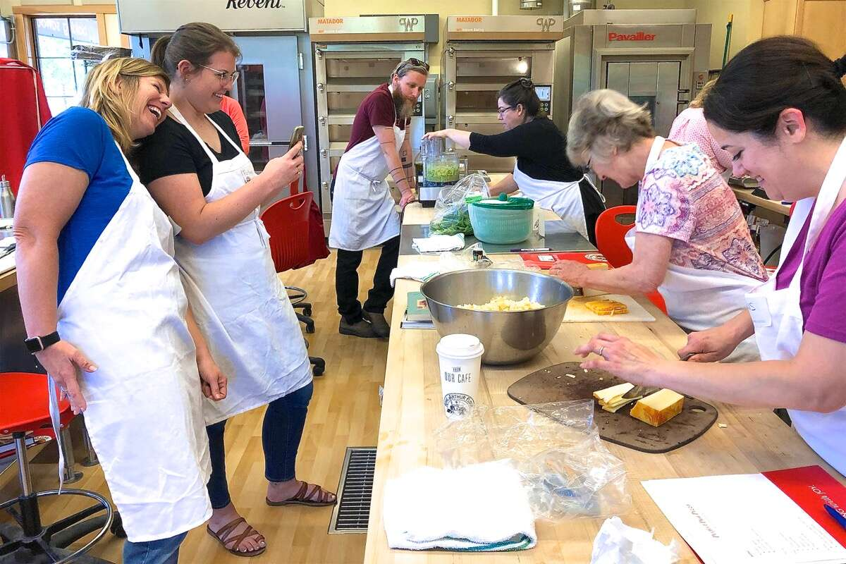 Women taking photos at a King Arthur Baking School class.