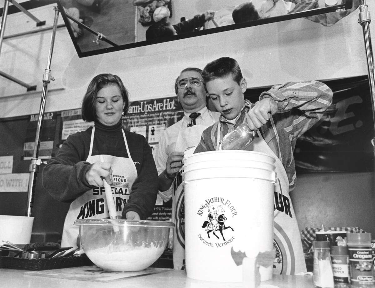 Two students and an adult teacher at a King Arthur bread baking class from 1992.