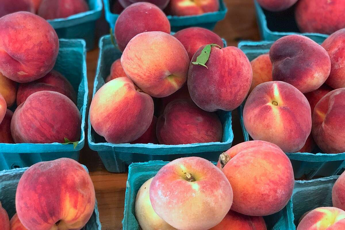 Fresh peaches from Crow Farm in Sandwich, Massachusetts, stacked in baskets and ready to sell.