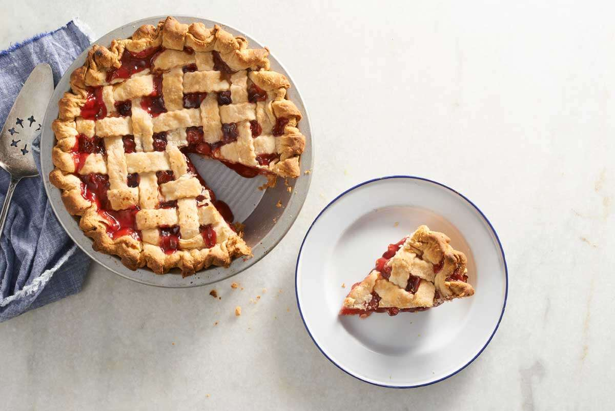 Lattice cherry pie with slice cut out
